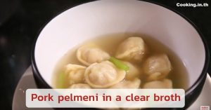 Pork pelmeni in a clear broth